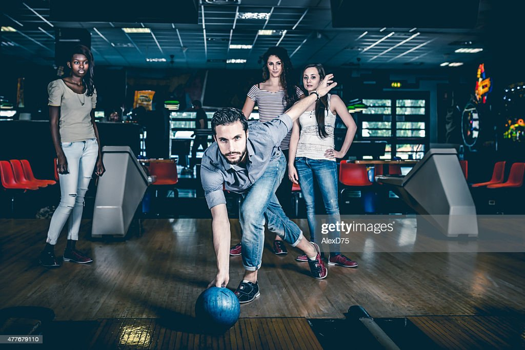 Friends playing bowling : Stock Photo