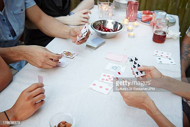 Friends playing card game at garden party