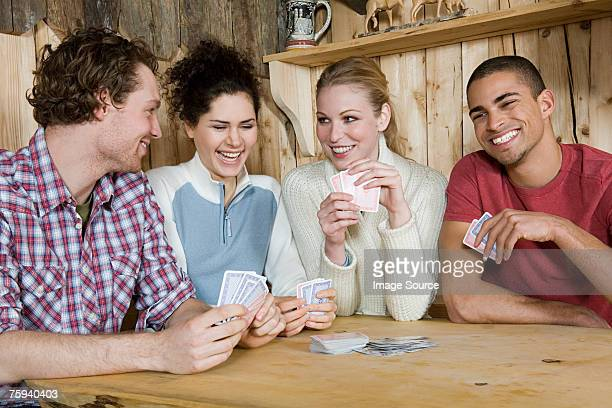 Friends playing cards in cabin
