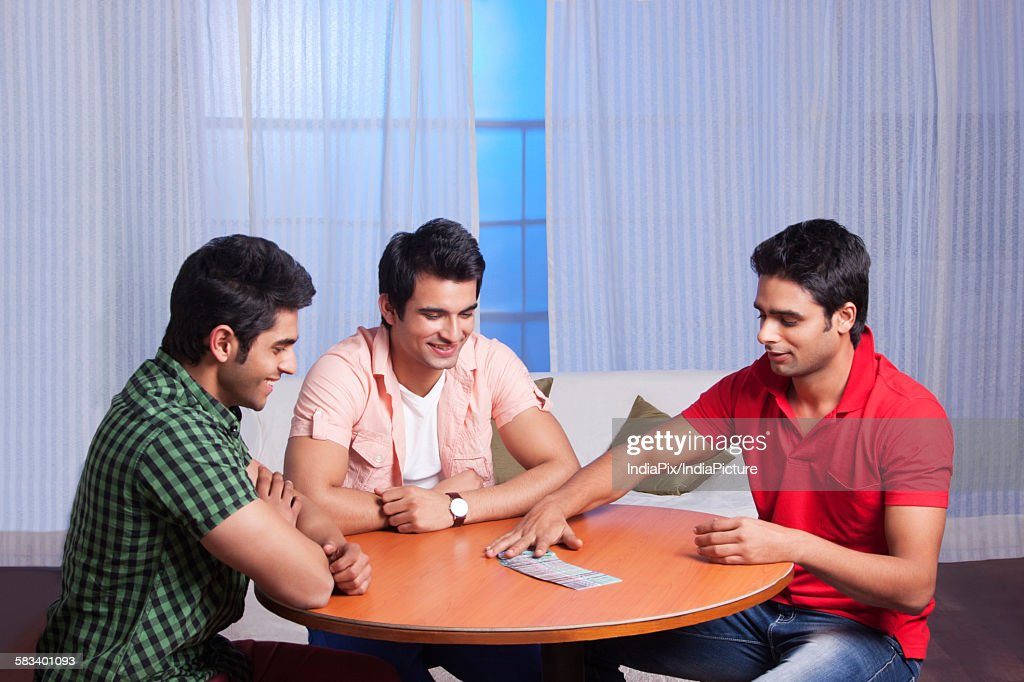 Friends playing cards : Stock Photo