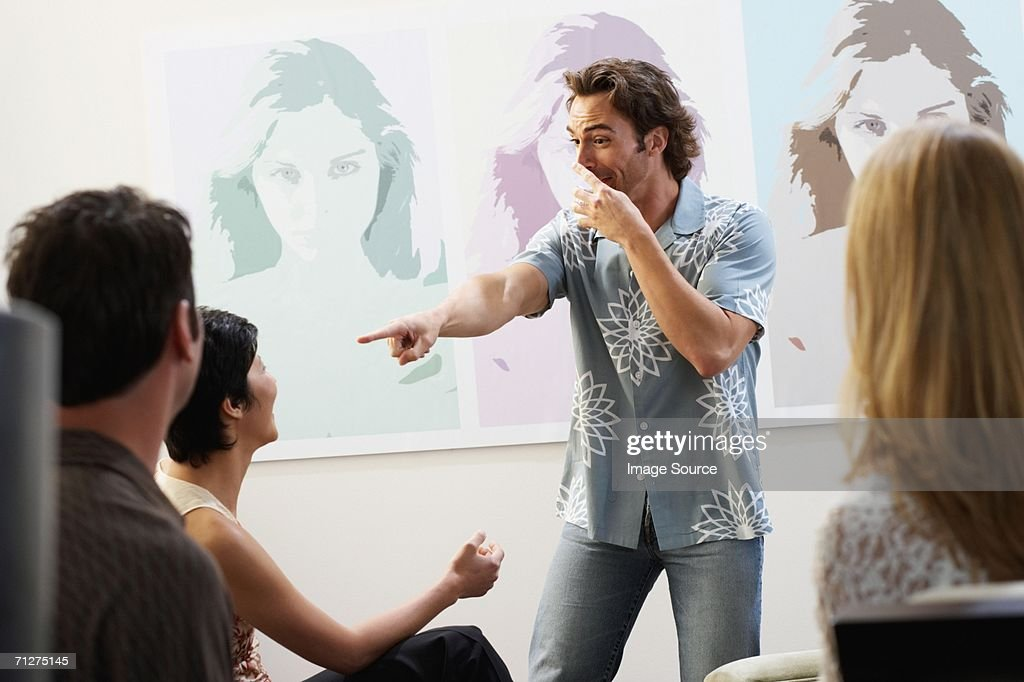 Friends playing charades : Stock Photo