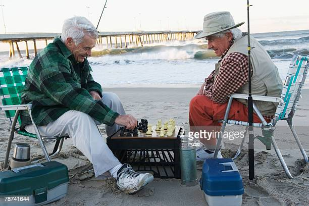 Friends Playing Chess on the Beach