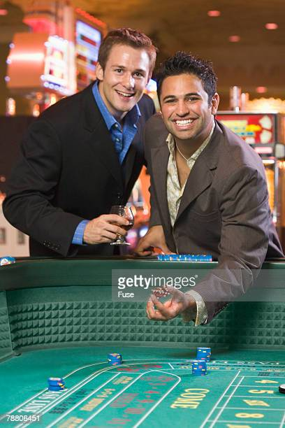 friends playing craps - gambling table stock pictures, royalty-free photos & images