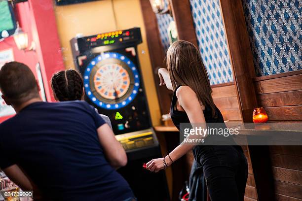 friends playing darts in a club - darts stock pictures, royalty-free photos & images
