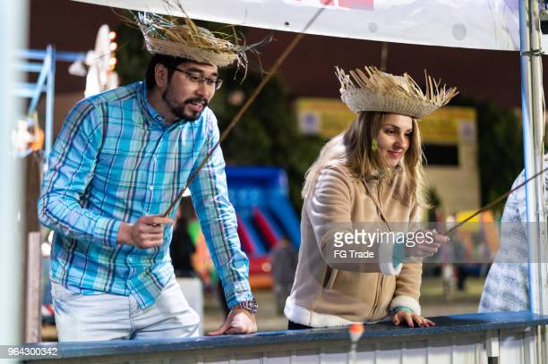 friends playing fishing in the traditional brazilian junina party - brazilian men stock photos and pictures