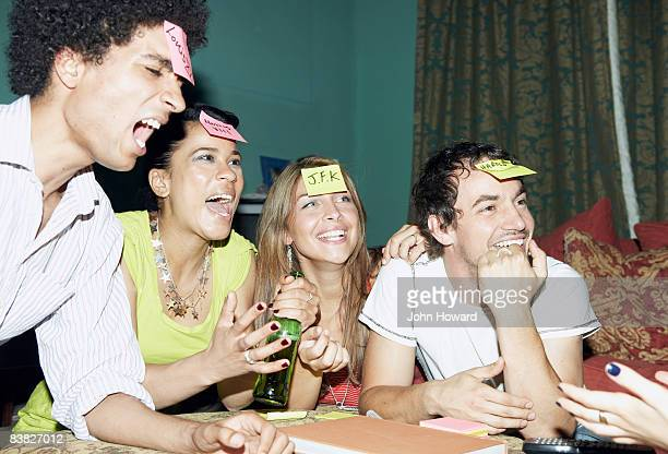 friends playing game - forehead stock pictures, royalty-free photos & images