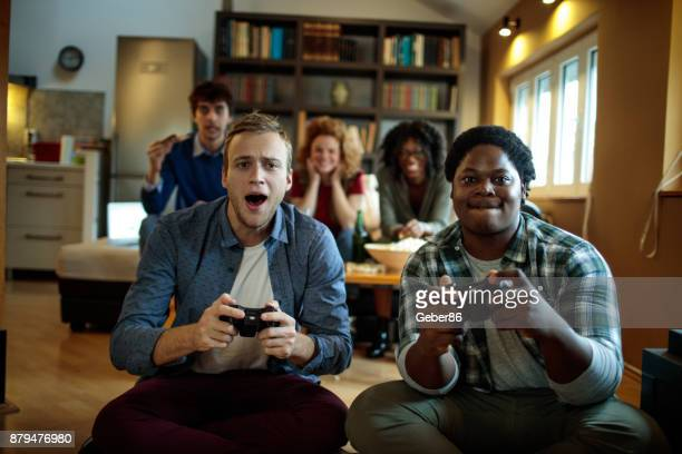 friends playing games - gamer stock pictures, royalty-free photos & images