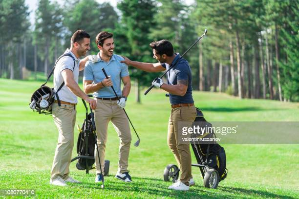 friends playing golf on a beautiful sunny day - golfe imagens e fotografias de stock
