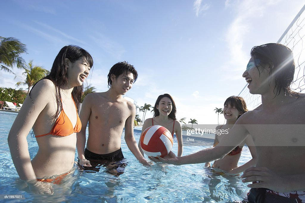 Friends Playing in a Swimming Pool : Stock Photo