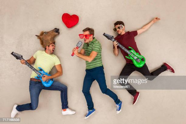 Friends playing music in a rock band