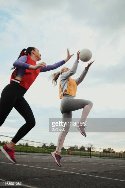 friends playing netball - sporting term stock pictures, royalty-free photos & images