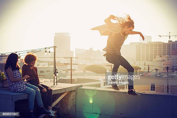 Friends playing on urban rooftop