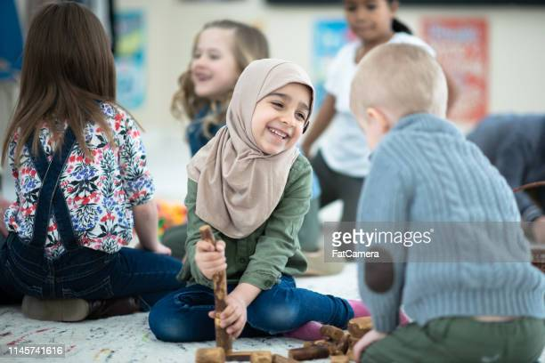 friends playing - montessori education stock pictures, royalty-free photos & images