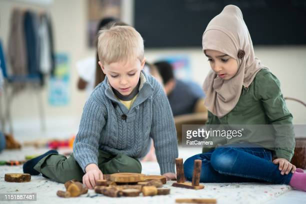 friends playing - religious dress stock photos and pictures