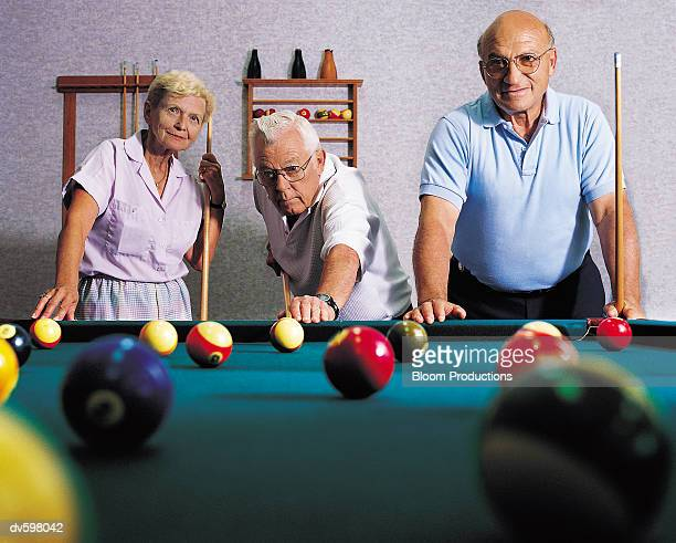 friends playing pool - old men playing pool stock pictures, royalty-free photos & images