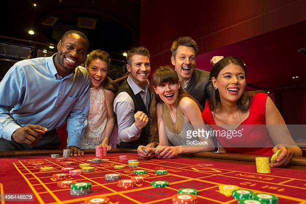 friends playing roulette - casino stock pictures, royalty-free photos & images
