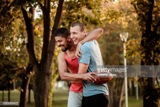 friends playing rugby outdoors - funny rugby stock photos and pictures
