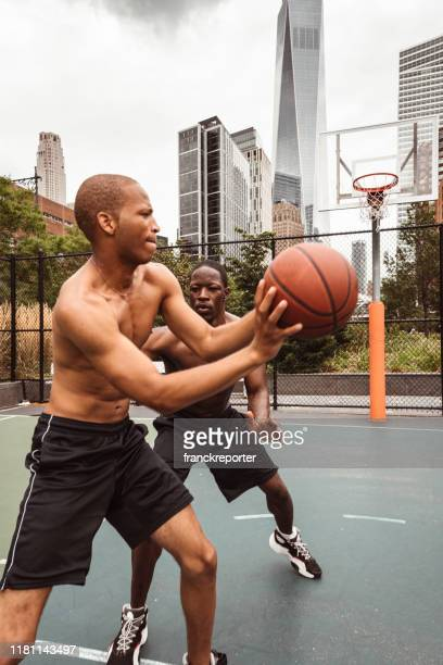 friends playing street basketball in nyc - sports round stock pictures, royalty-free photos & images
