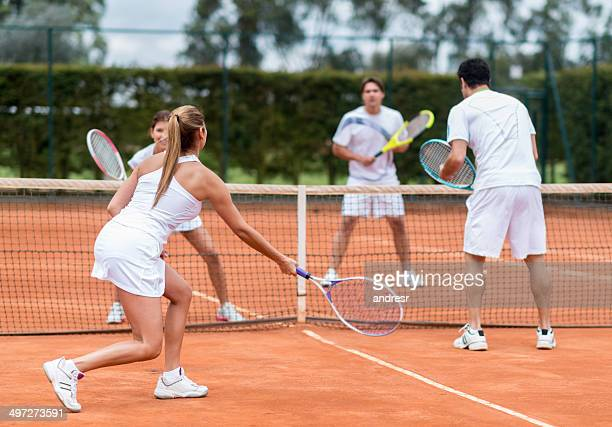 friends playing tennis - doubles stock photos and pictures