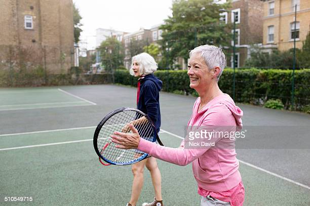 friends playing tennis - leanincollection stock pictures, royalty-free photos & images