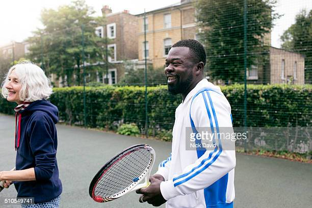 friends playing tennis - 35 year old man stock pictures, royalty-free photos & images