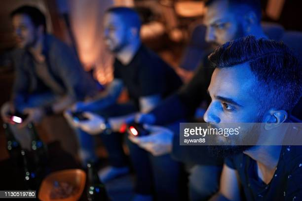 friends playing video games - gamer stock pictures, royalty-free photos & images