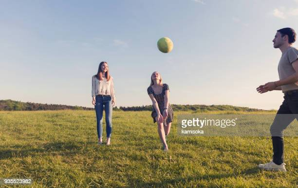 friends playing volleyball at sunset - taking a shot sport stock pictures, royalty-free photos & images