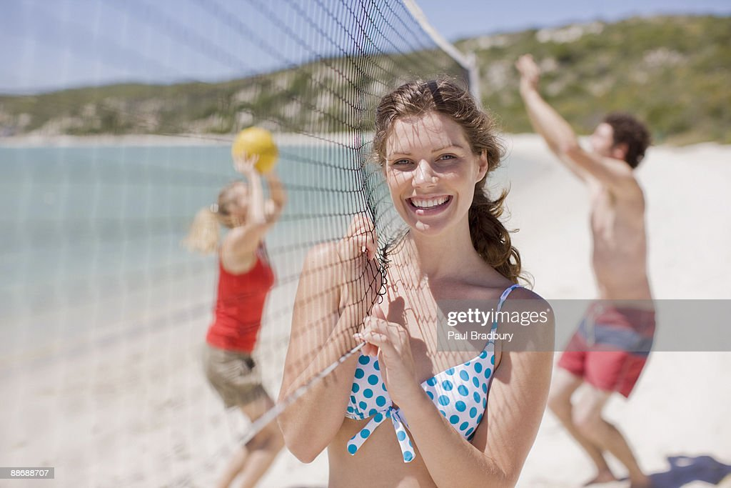 Friends playing volleyball : Stock Photo