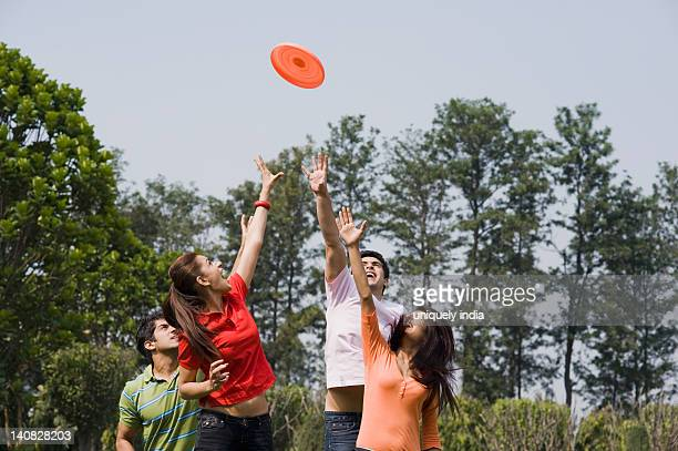 Friends playing with a plastic disc