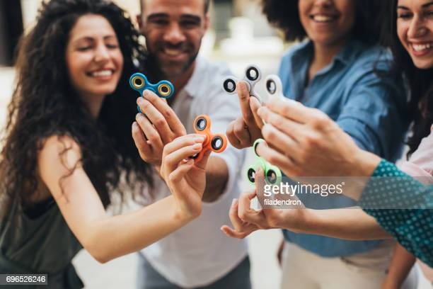 Friends playing with a spinner