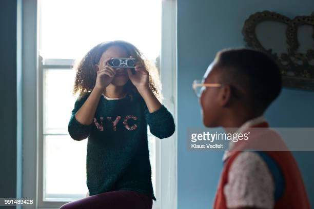 Friends playing with binoculars
