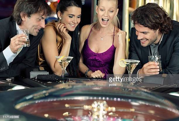 friends plays in the casino on electronic roulette