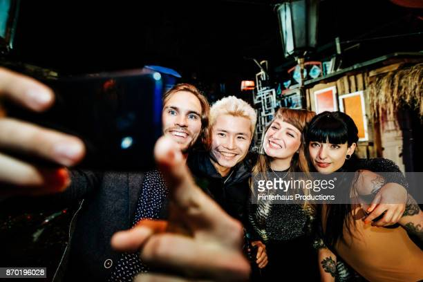 Friends Pose For Selfie While On Night Out Together