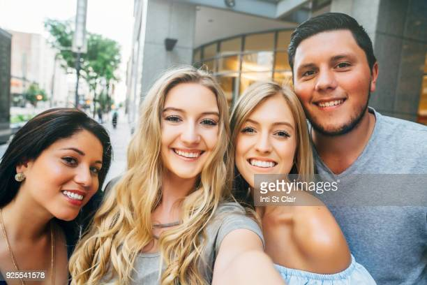 friends posing for cell phone selfie - multiculturalism stock pictures, royalty-free photos & images