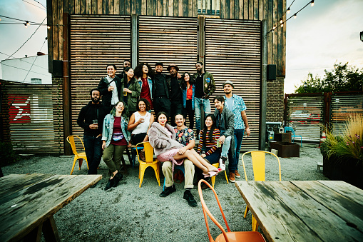 Friends posing for group photo during party at outdoor restaurant - gettyimageskorea