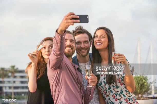 Friends posing for selfie together