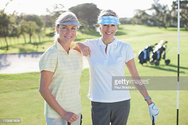 Friends posing on golf course
