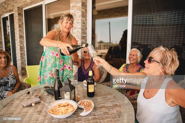 friends pouring a glass of champagne - republic of cyprus stock pictures, royalty-free photos & images