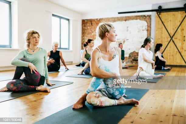 friends practicing yoga together - yoga stockfoto's en -beelden