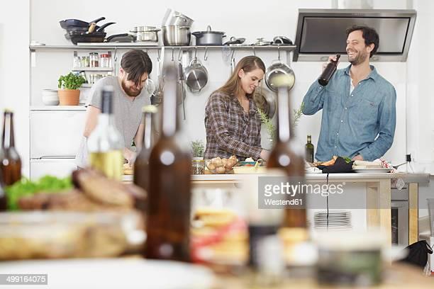 Friends preparing food in kitchen