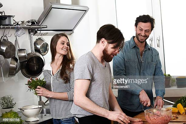 Friends preparing food in kitchen