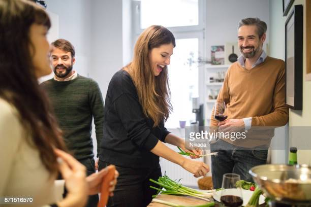 friends preparing food in kitchen - mid adult women stock pictures, royalty-free photos & images