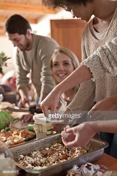 Friends preparing meal together