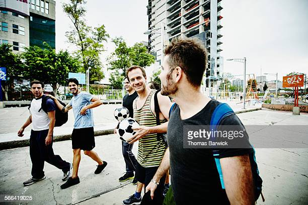 Friends preparing to play pick up soccer game