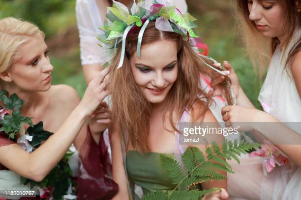 friends preparing young woman for womanhood - garland stock pictures, royalty-free photos & images