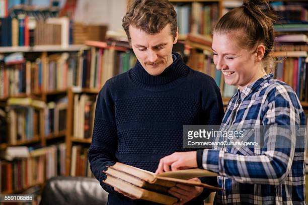Friends reading in second hand bookstore
