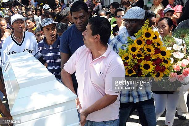 Friends relatives and other people carry the coffin with the remains of Ana Fabricia Cordoba Cabrera at San Pedro cemetery on June 9 in Medellin...