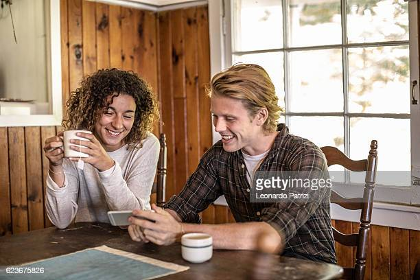 friends relax and enjoy an hot coffee at home