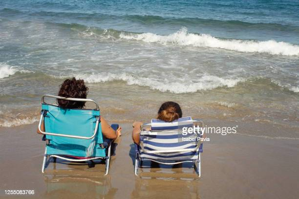 friends relaxed at beach - sun lounger stock pictures, royalty-free photos & images