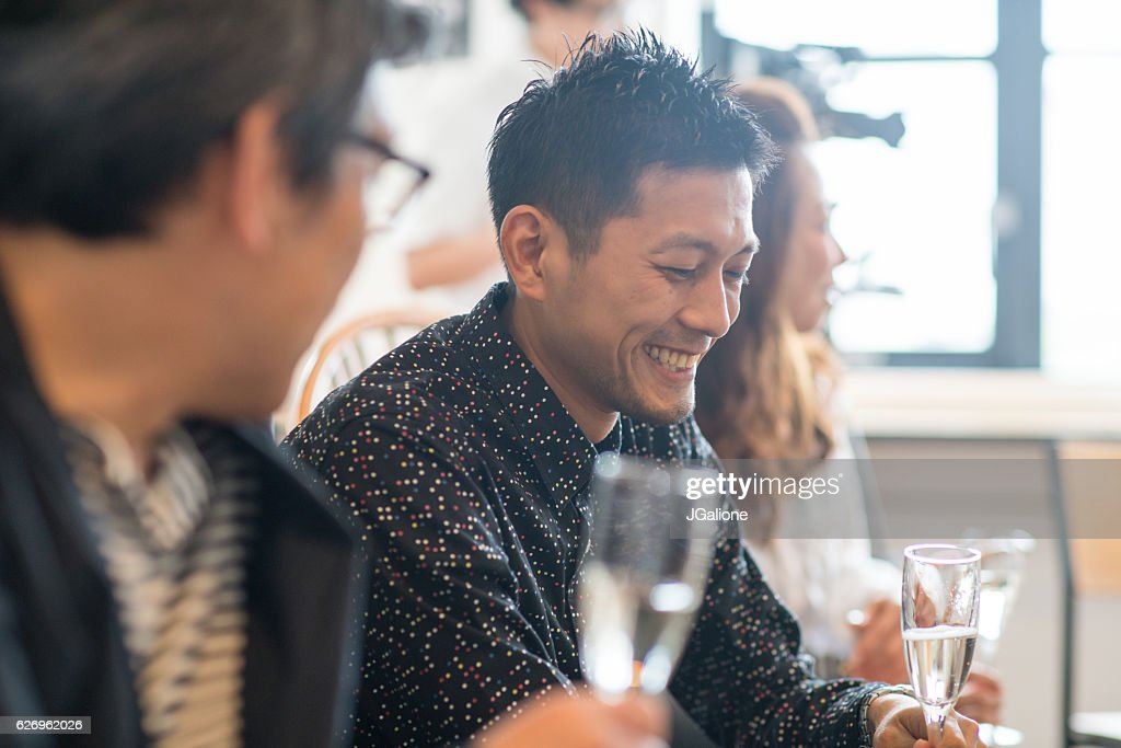 Friends relaxing and drinking wine : Stock Photo